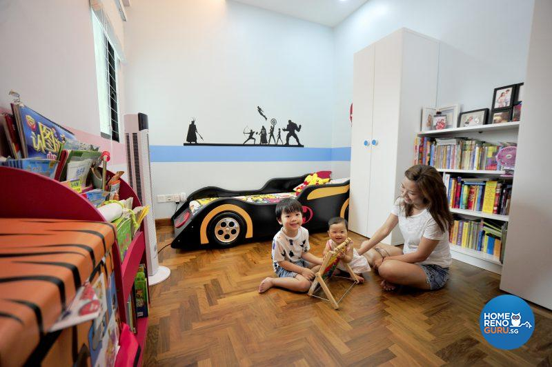 The wall mural spans the length of one wall above the batmobile-themed bed, inspiring superhero dreams!