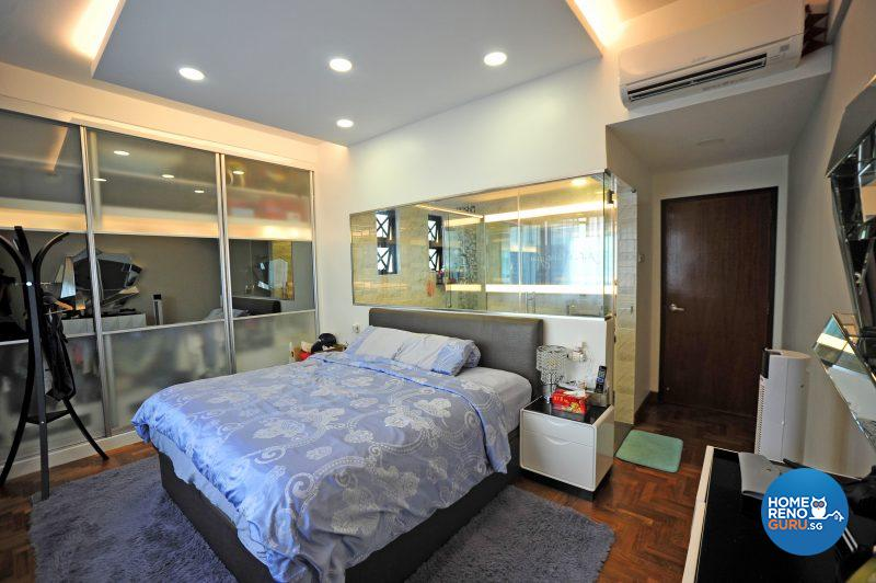 The master bedroom features a window into the master bathroom