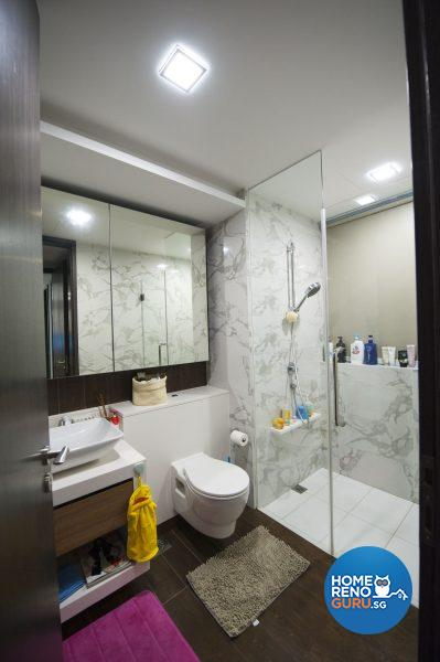 The luxurious fully tiled bathroom is illuminated with down lights
