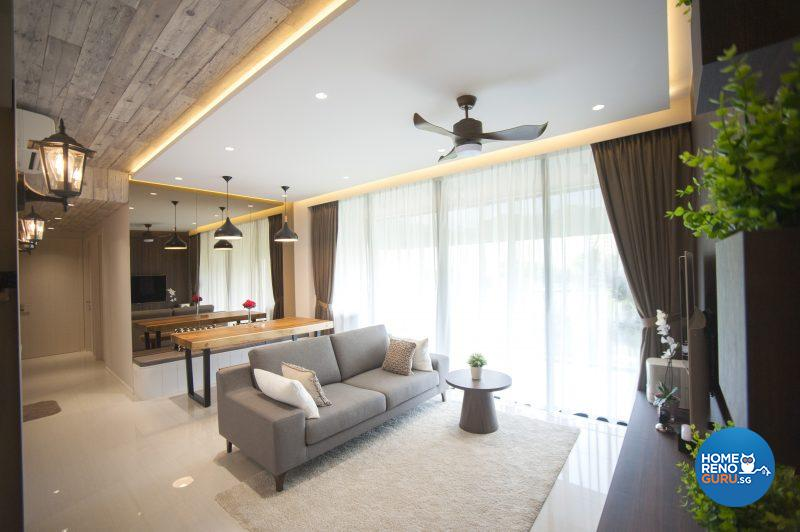 The wood-lookalike wallpaper on the ceiling heightens the cosy, rustic feel of the living area