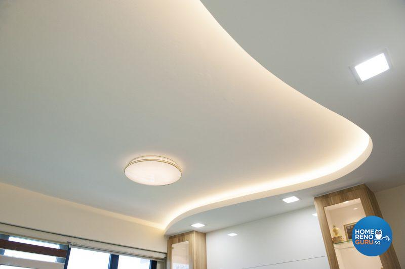 The distinctive curve in the living area ceiling conceals mood-setting cove lighting