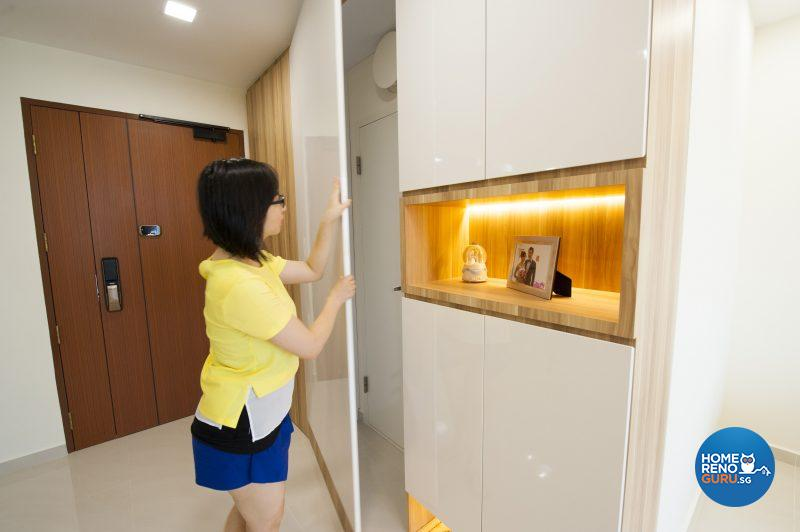 Concealed storage alongside the spotlit display cabinet