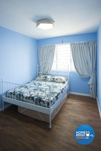 The sky-blue spare bedroom