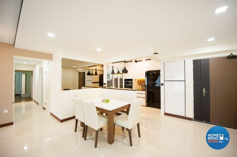 An open concept kitchen and dining area, semi-divided by a breakfast bar