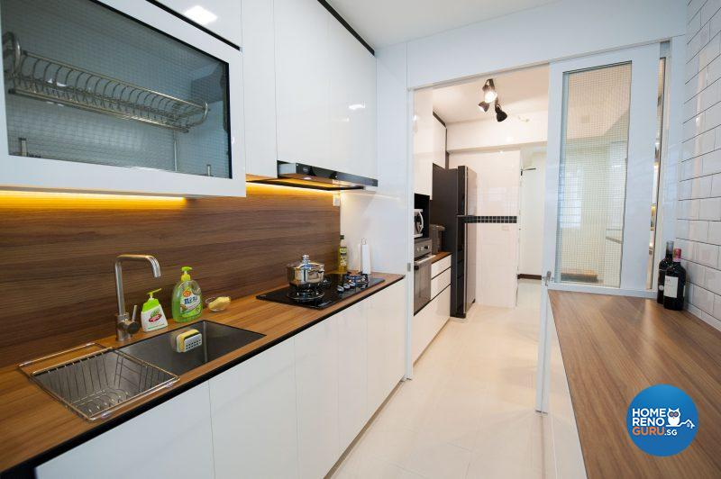 The sleek and elegant kitchen, with wood-lookalike countertops