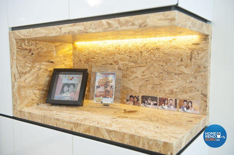 A spotlit display cabinet sits above the concealed shoe cabinet