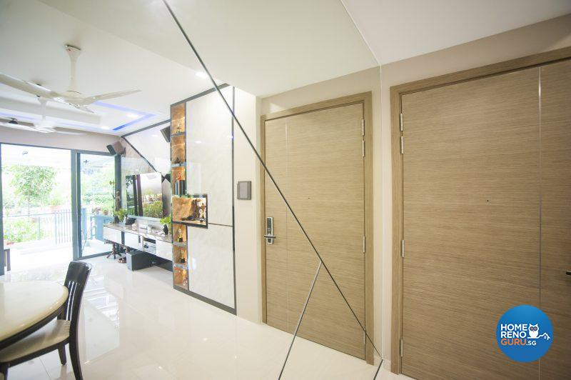 Both the feature wall behind the TV console and the mirrored panel feature a distinctive criss-cross pattern