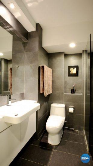 Bathroom with matching dark grey wall and floor tiles