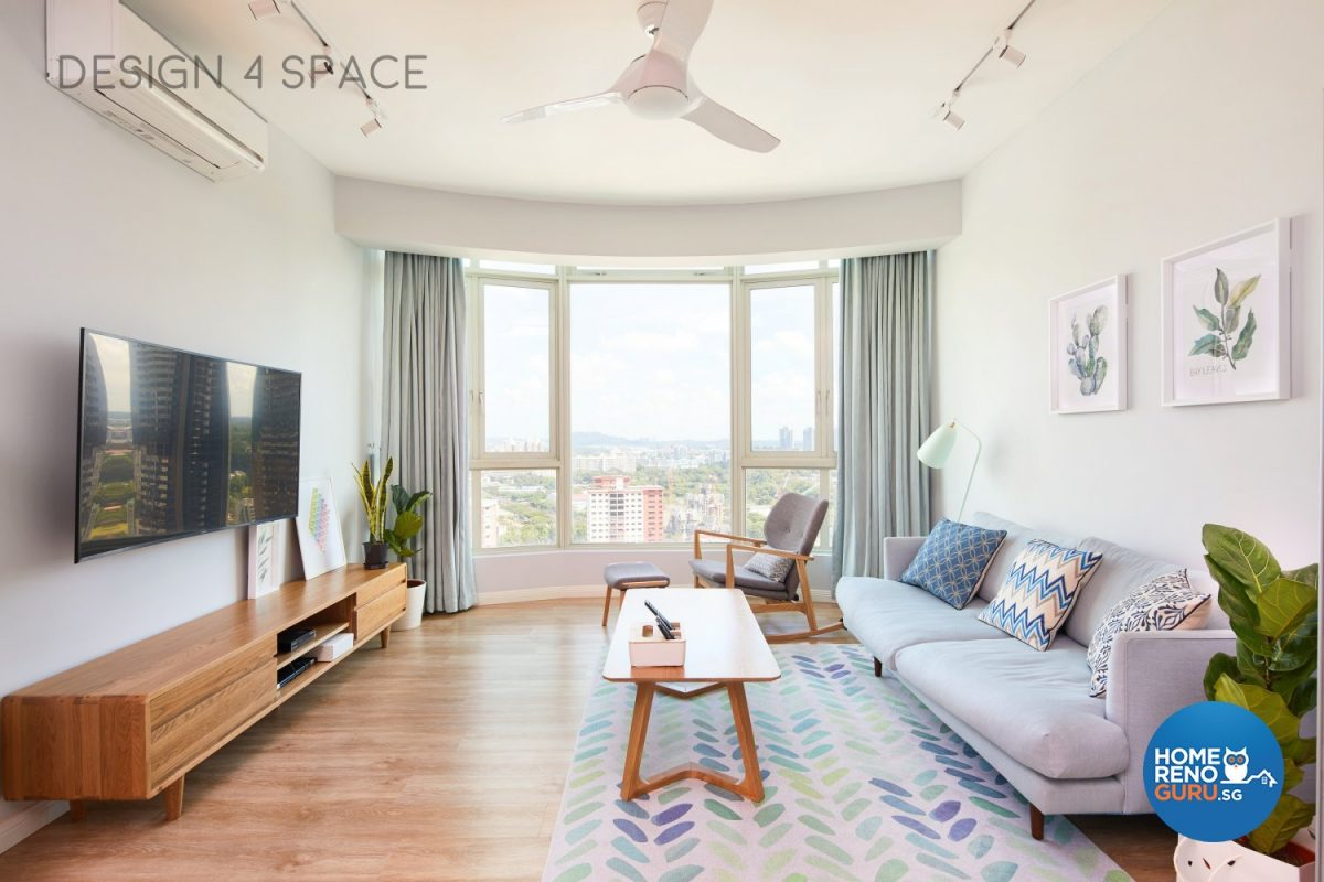 Modern condominium living room with blue sofa and wooden coffee table