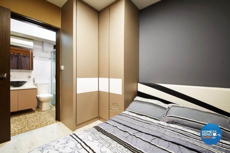 Bedroom with brown wardrobes and bed with black, grey and white stripes