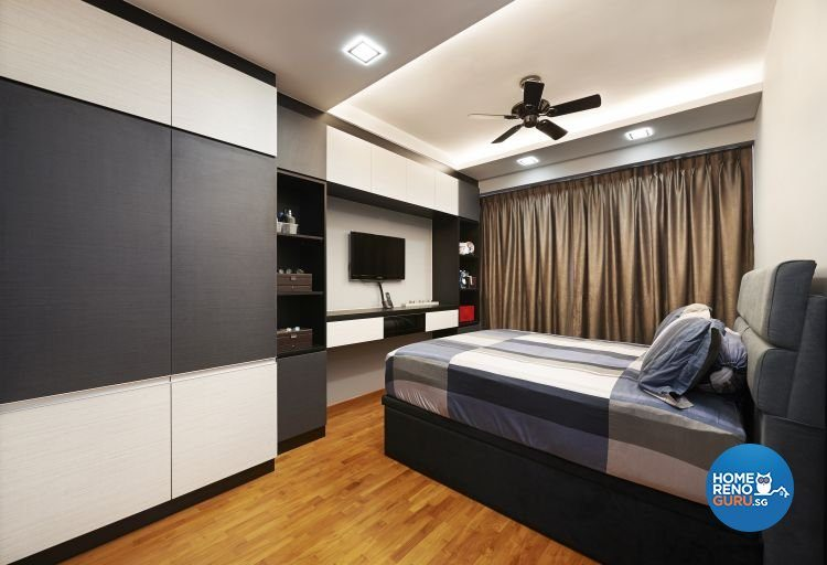 Bedroom with grey and white wardrobe, wall-mounted tv and single bed