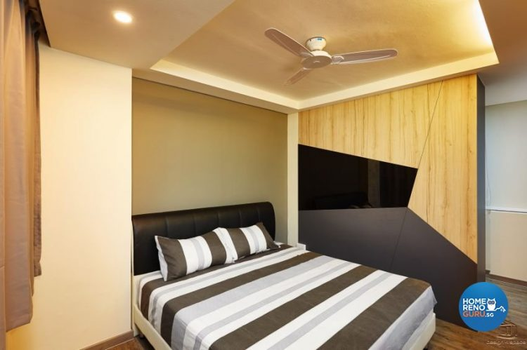 Bed with black, grey and white stripes and wardrobe with black, brown and grey trapezium design
