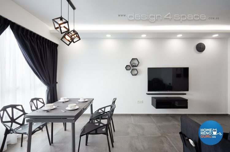 Spacious dining room with black table, chairs and tv and hanging square lights