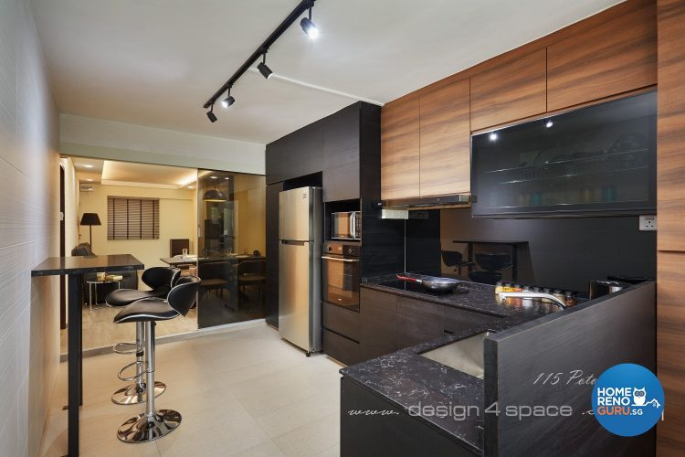 Kitchen with black countertop and brown shelf doors