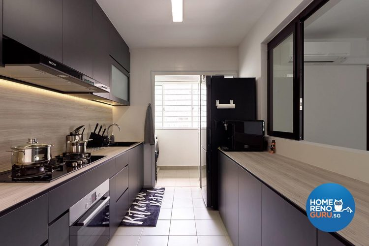 Kitchen with black shelves and wooden countertop and black fridge