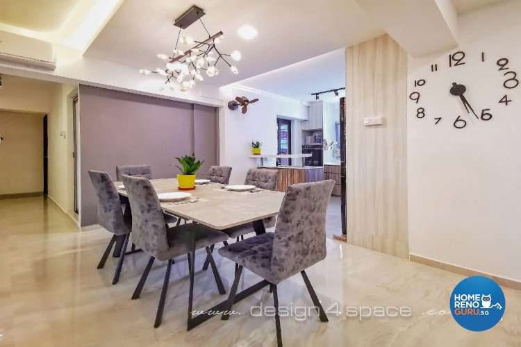 Grey chairs and beige table with special hanging lights