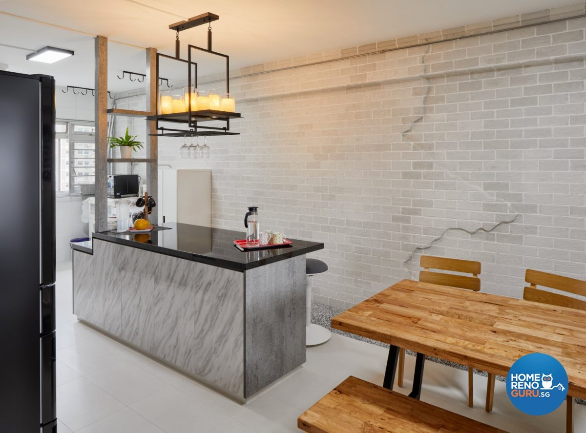 Wooden dining table and chairs, marble kitchen counter and hanging lights