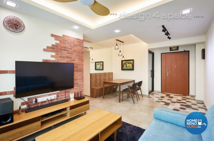 Half brick feature wall with wall-mounted tv, bright blue sofa and brown coffee table