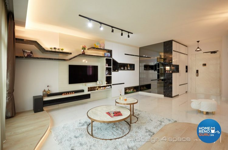 White circular coffee tables, light grey rug and wall-mounted tv in the living room