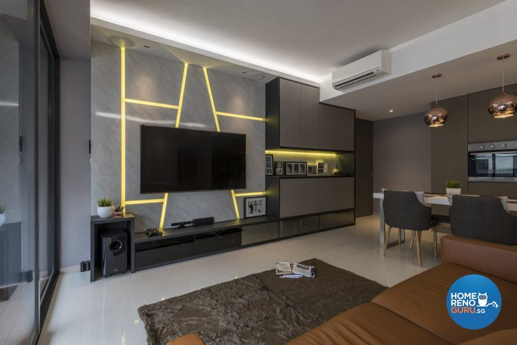 Grey wall with neon yellow lines, wall-mounted tv and brown rug
