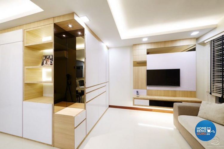 White walls with wooden rectangles and wall mounted tv