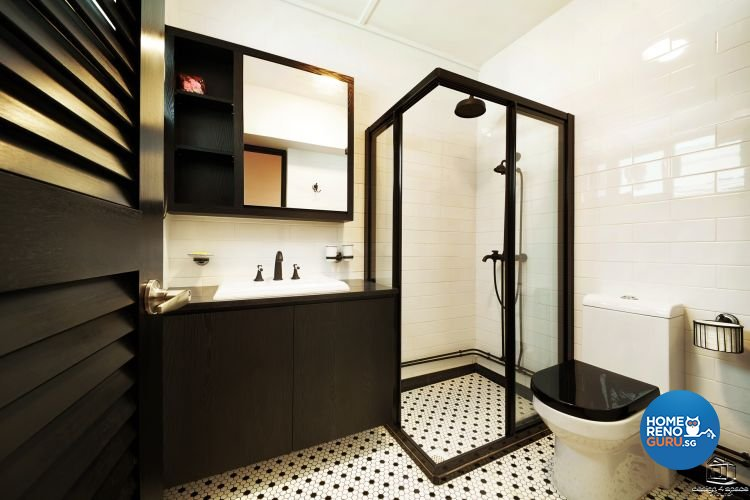 Tiled floors, black standing shower and black cupboards and white toilet bowl with black cover
