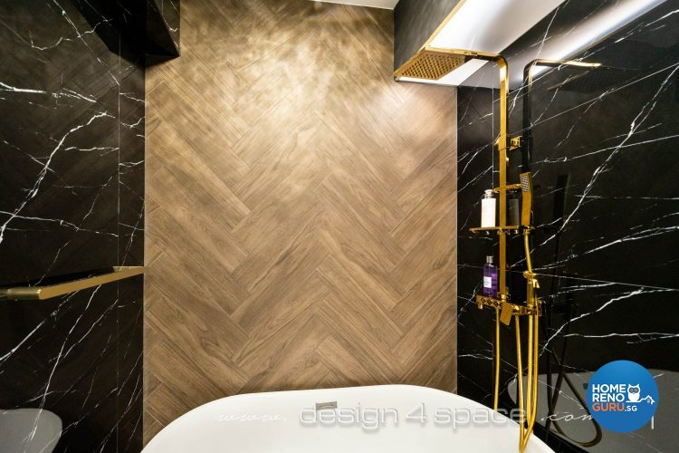Golden standing shower and white tub, black marble wall and wooden feature wall