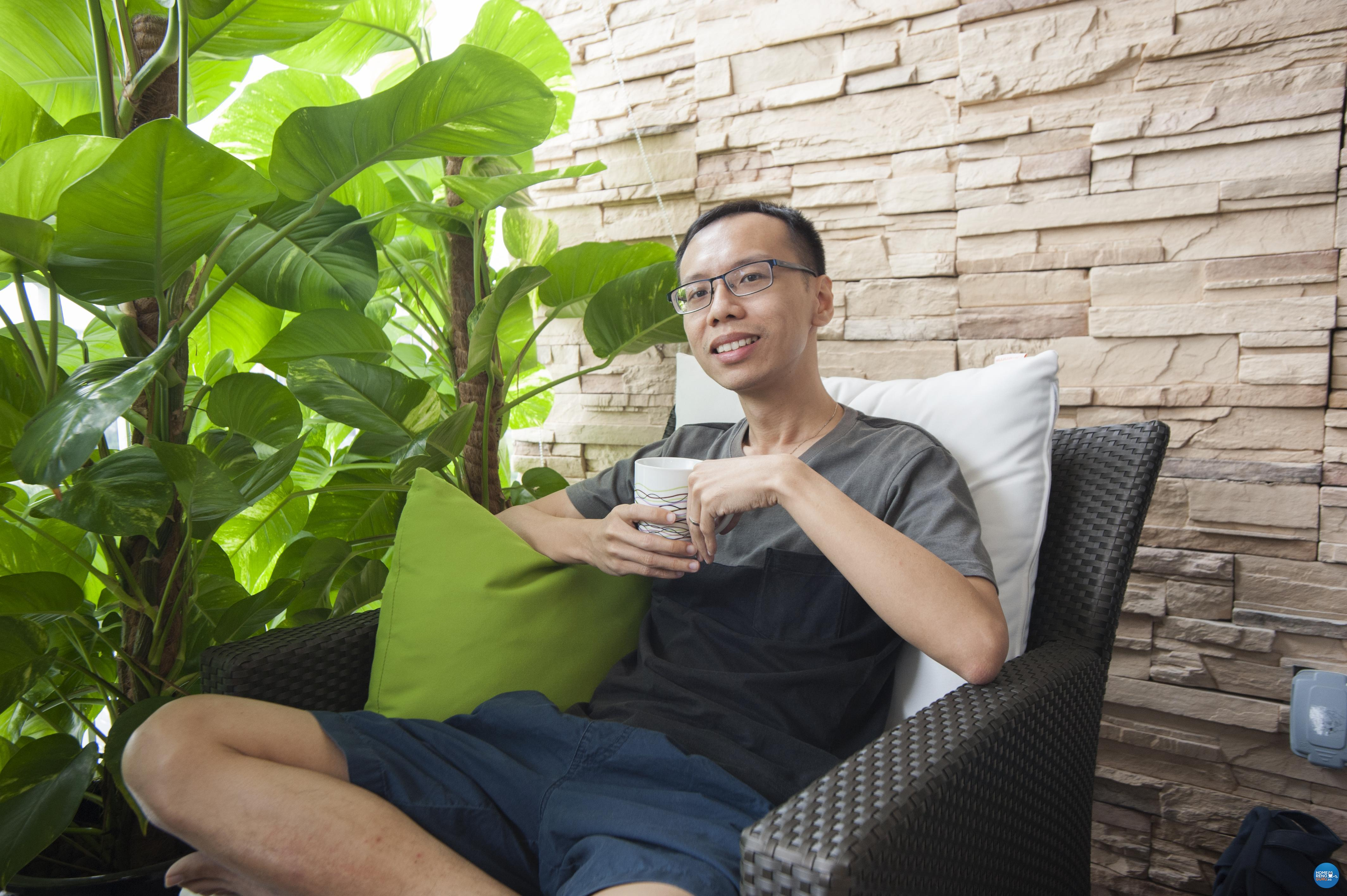 Happy homeowner Gabriel Seow on his beloved balcony