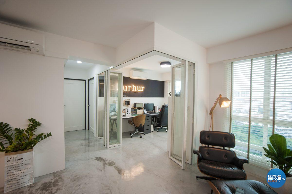 The office is separated from the living area with concertina-folding glass doors