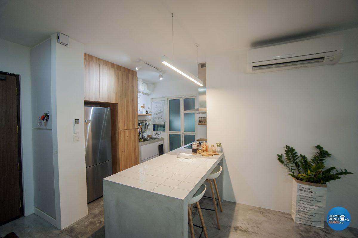 A kitchen counter doubles as casual seating and room divider