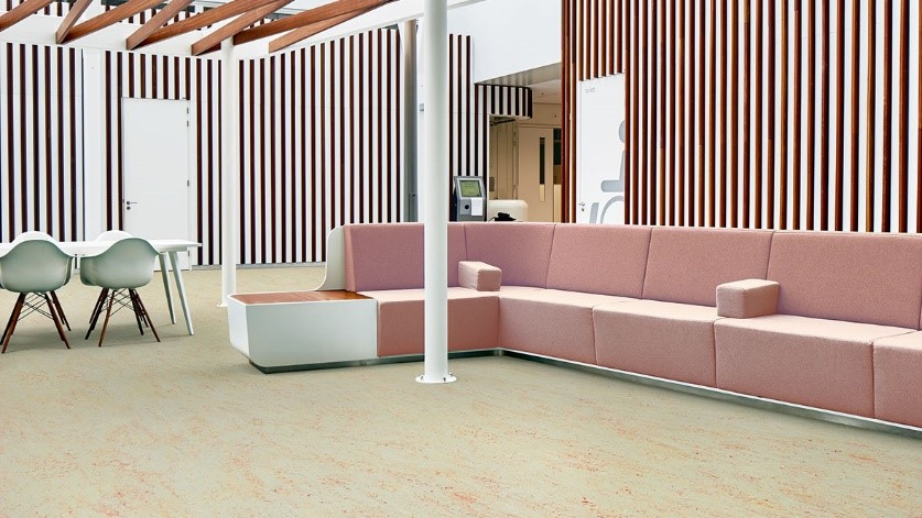 Room with pink sofa and white furniture