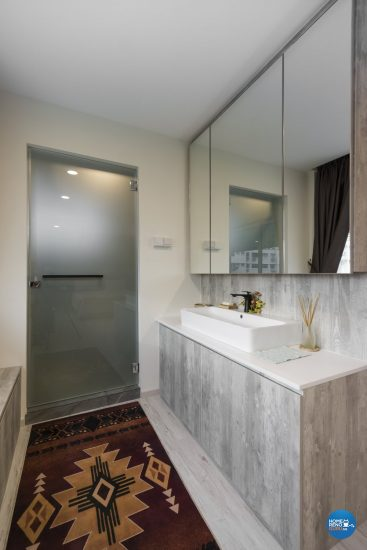 Long bathroom with multiple large wall-mounted cabinets with mirror doors