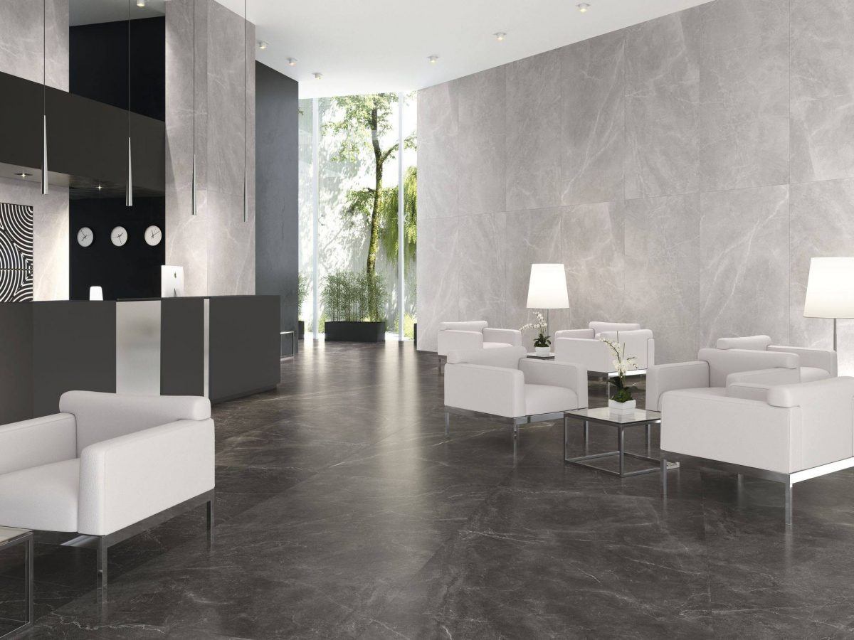Monochromatic lobby area with black flooring and white couches