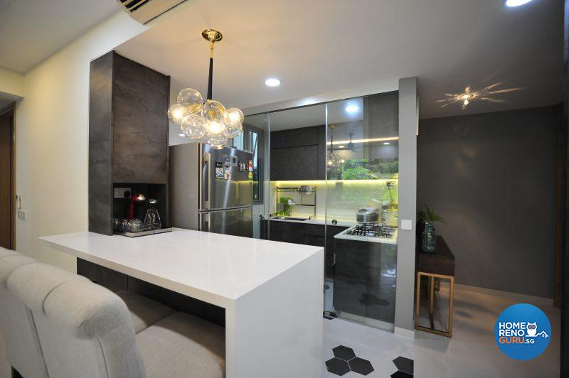 A statement lamp adds a touch of glamour over the dining area, which faces the completely rebuilt open concept kitchen