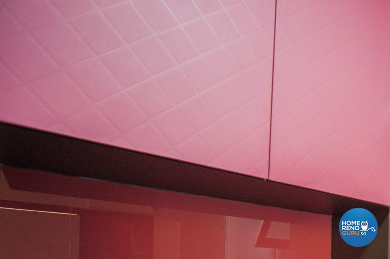 A coral pink laminate with an upholstered texture in the kitchen