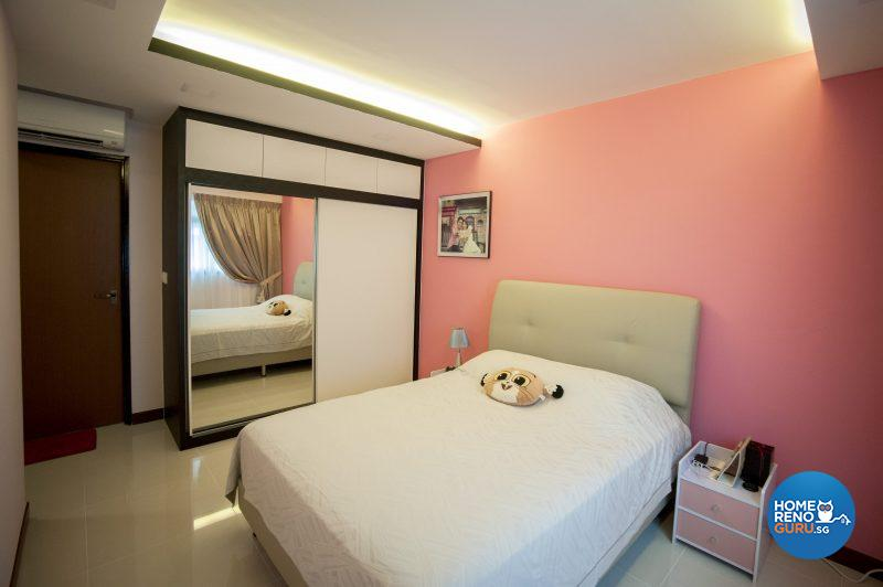 The master bedroom sports a feature wall in coral pink