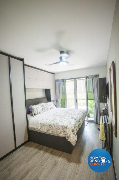 The master bedroom features floor-to-ceiling built-in closets and wood-lookalike flooring