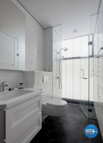 White-themed bathroom with a wall-mounted toilet bowl