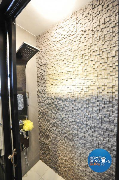 The sleek shower cubicle has a textured tiled wall