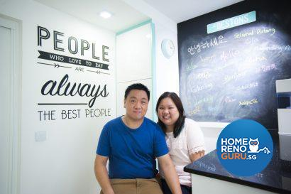 Desmond and Tiffany in front of their evolving work of art – the chalkboard adorned with guests' messages