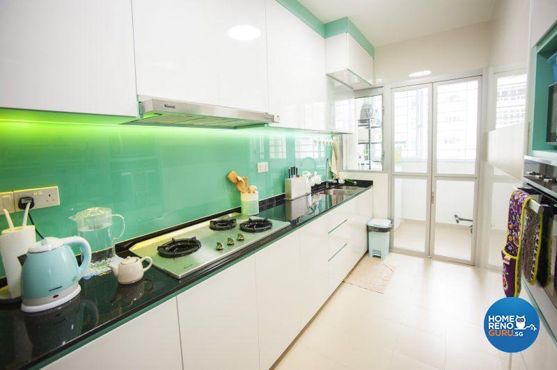 The spacious, functional kitchen is brought to life with black countertops and a turquoise tempered glass splashback