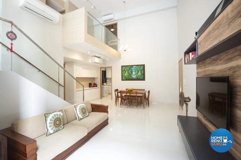 The spacious downstairs living area has a resort-like feel with clean white surfaces and wooden furnishings