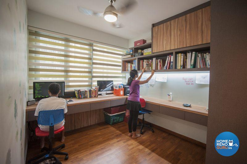 The study for the older children retains the original built-in cupboards