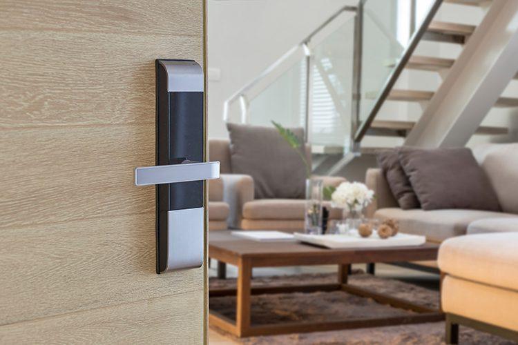 Door with digital door lock opening to a modern looking home