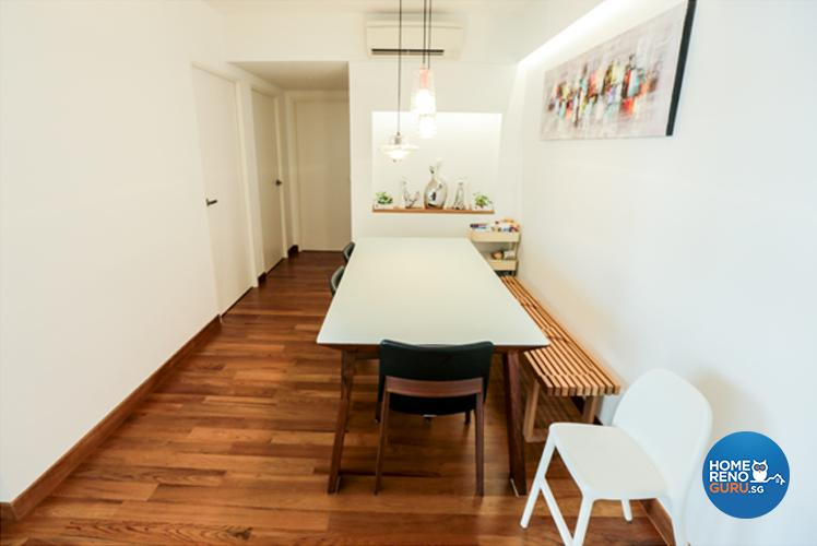 the-dining-area-is-distinguished-by-spotlit-recessed-chelving-and-a-vibrant-painting