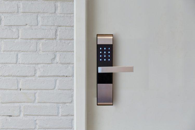 elegant digital door lock installed on a white door